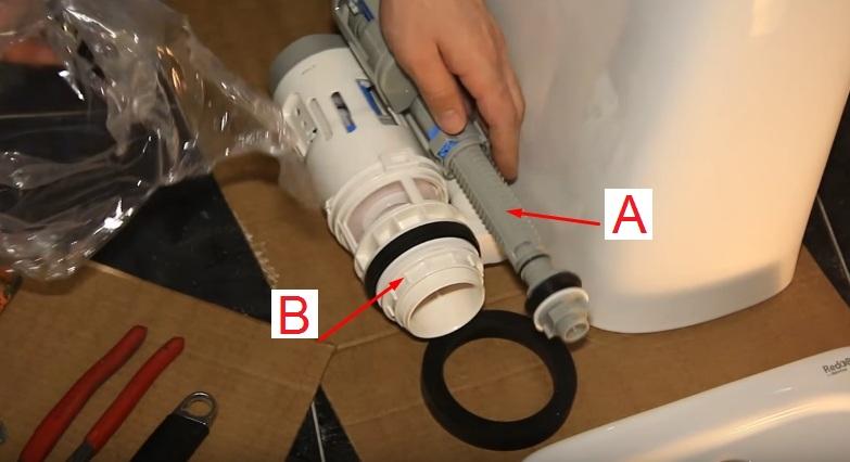 Арматура для сливного бачка унитаза. А – Заливной клапан, необходим для пополнения емкости водой. В – Сливной клапан, отвечает за ее сброс в чашу унитаза